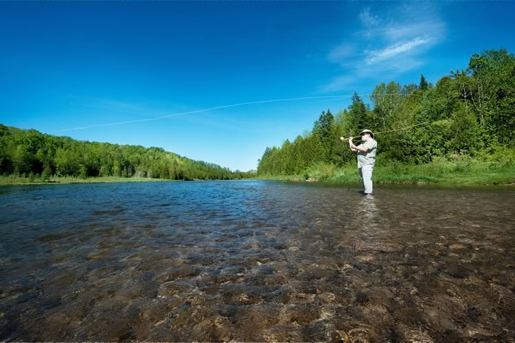 Fly fishing on the Pine River. Photo by Rosemary Hasner / Black Dog Creative Arts.