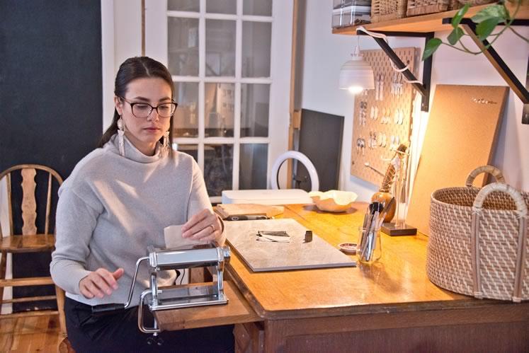 Jewelry maker Kristin Evensen at work in her Orangeville studio. Photo by Pete Paterson.