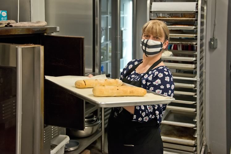 Baker and owner Cristina Roque works in the quiet of her kitchen at Orangeville's Son of a Chef Bakery. Photo by Pete Paterson.