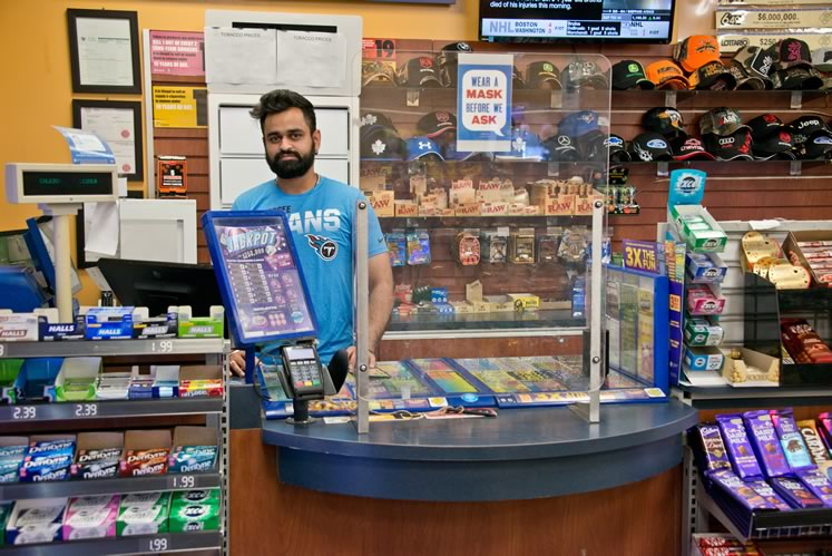 Varun Sharma works late hours behind the counter as store supervisor at the Ultramar and Express Mart in Caledon. Photo by Pete Paterson.