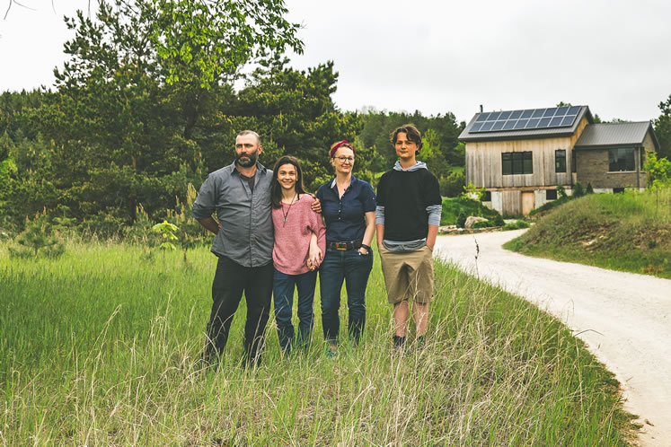 Peter, Isobel, Sara and Jackson have raised heritage pigs and now grow strawberries and high-bush blueberries on the Mitchell Family Farm. Photo by Erin Fitzgibbon.