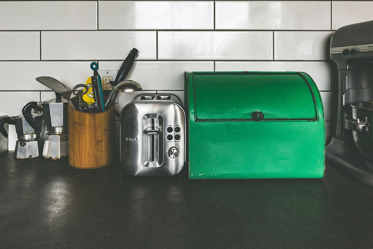 Vintage kitchen accessories add to the room's nonconformist vibe. Photo by Erin Fitzgibbon.