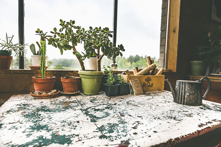 Thanks to its spattered surface, a worktable strikes an artful note. Photo by Erin Fitzgibbon.