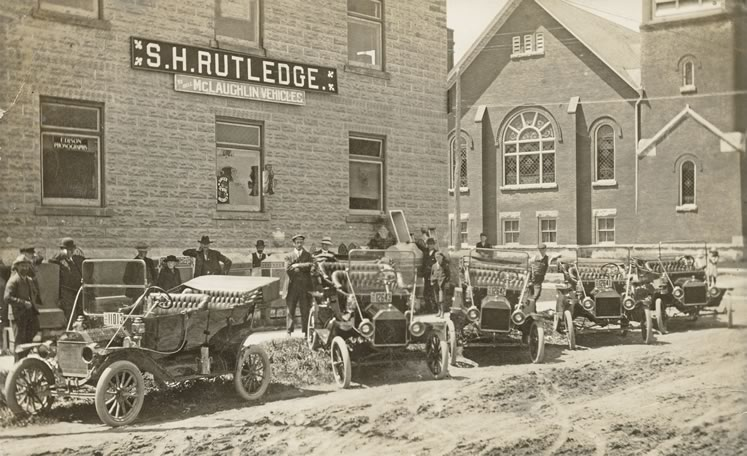 S.H. Rutledge opened an early dealership on Owen Sound Street in Shelburne (shown c.1920), selling McLaughlin automobiles. Photo Courtesy Dufferin County Museum And Archives.
