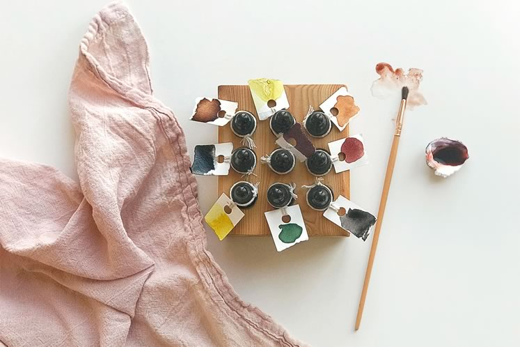 A selection of Melissa's handmade inks, each with a sample drop on its label. Photo courtesy ofMelissa Jenkins.