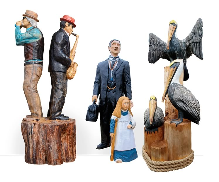 """Jim Menken has contributed more than 30 works to Orangeville's Art Walk of Tree Sculptures, including from left, """"The Musicians,"""" """"Physician and Patient,"""" and """"Pelicans."""""""