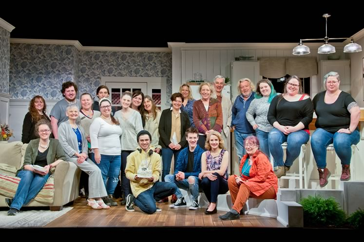 The cast and crew of Too Close to Home. The play opened and closed on one fateful night in March 2020, and the set then languished on stage for months afterward. The play will be restaged at a future date. Photo by Pete Paterson.