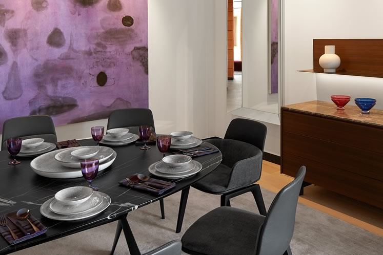 A dusky purple abstract by New York-based Canadian painter Bobbie Oliver pulls the dining area together. Photo by Ben Rahn.