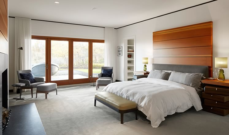 A rug from Toronto's Elte anchors the calm principal bedroom. Photo by Ben Rahn.