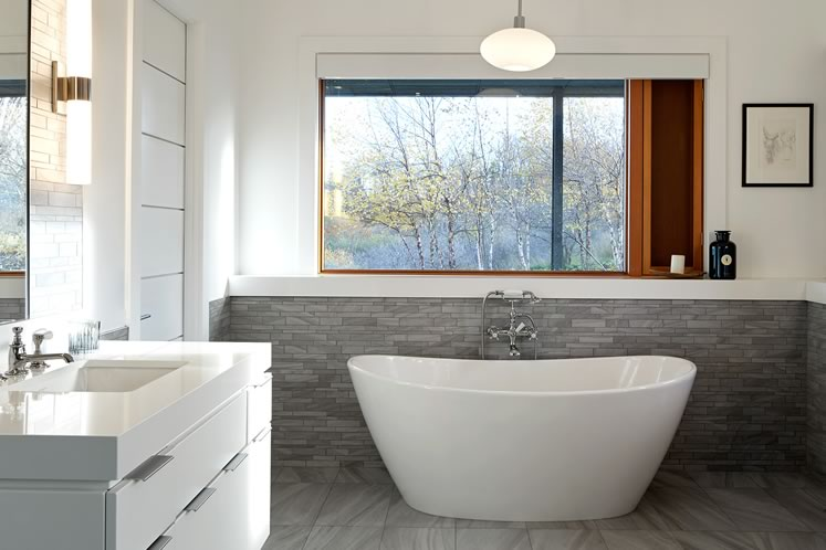 The owner says the freestanding tub in the marble-lined principal bathroom was a major factor in her decision to buy the home. Photo by Ben Rahn.